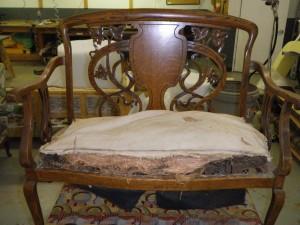 This worn love-seat bench needs rebuilding