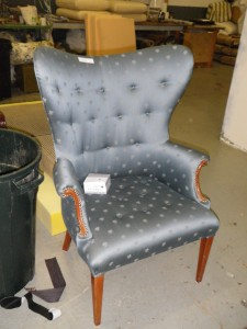 Old blue satin wing chair