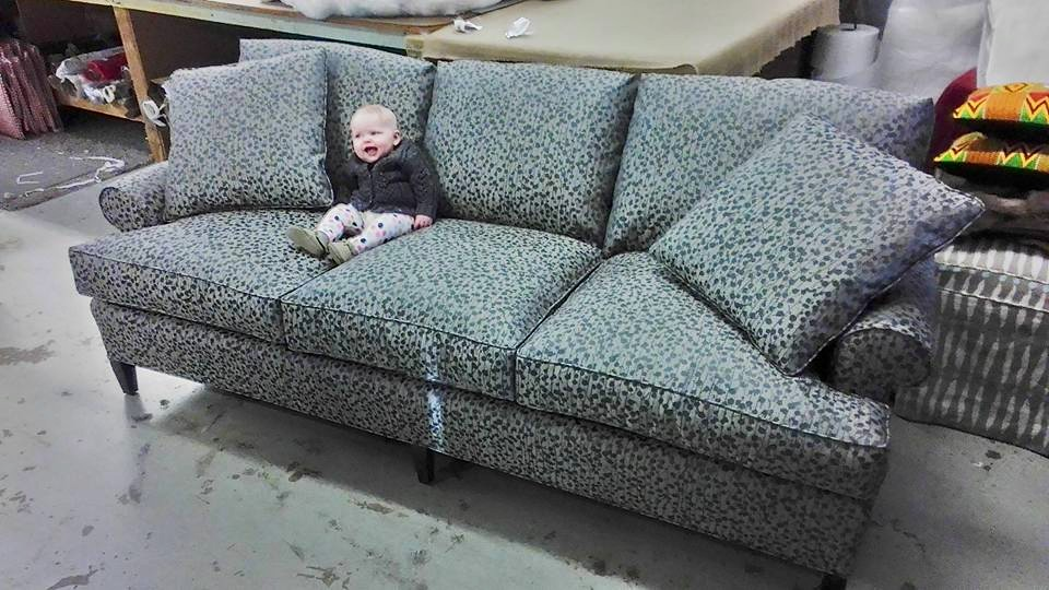 Blue couch with baby